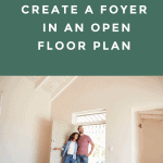 a couple standing in a door way to an large entryway that opens into the living room.