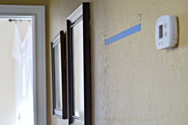 I've found this clever Picture Hanging Tip to be the best, especially for hanging frames with double hooks. Grab your painter's tape and get the tutorial at www.sharonehines.com