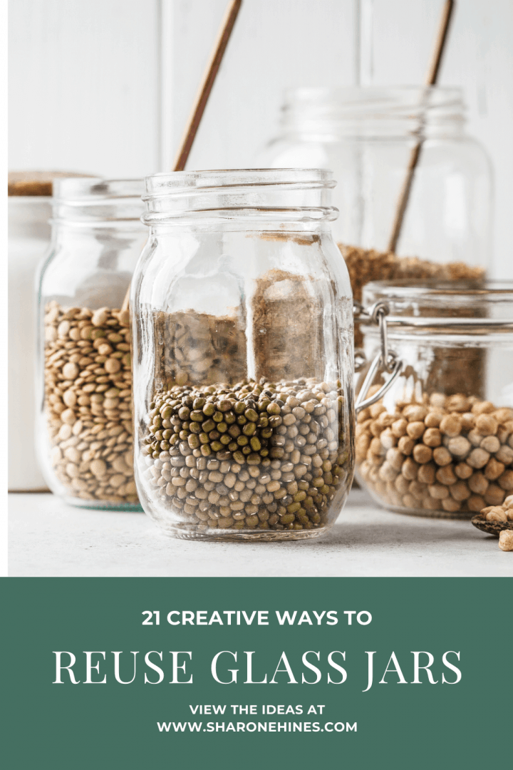 group of clear glass jars with dried foods in them like nuts, seeds and beans. Text on image says 21 clever ways to reuse glass jars.