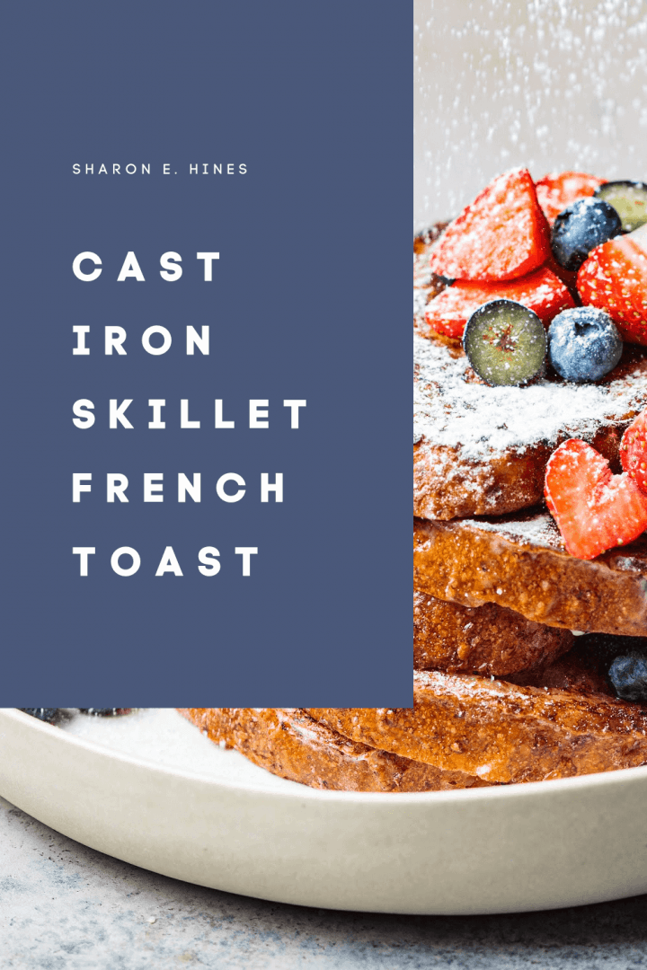 Pile of French toast topped with powdered sugar, blueberries and strawberries. Images text says Cast Iron Skillet French Toast.