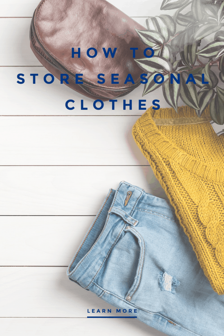 brown leather purse, green plant, gold cable knit sweater and light wash blue jeans laying across white shiplap planks with text that reads How to Store Seasonal Clothing